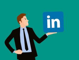 man holding LinkedIn logo