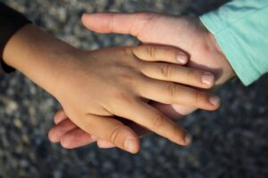 kid and adult hand