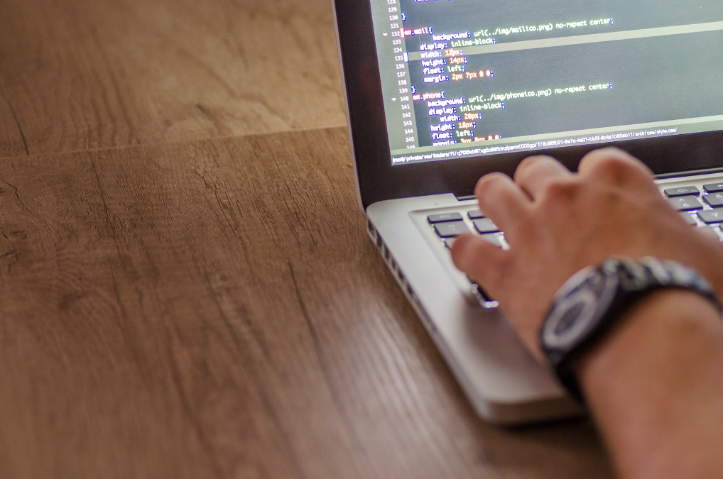 A man is coding for his WordPress web design service in Phoenix